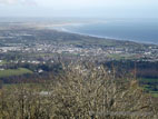 View over Newcastle and Dundrum from the top of a hill